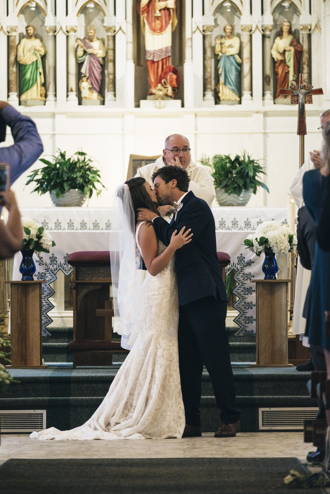 Bride and groom kiss for the first time as husband and wife during their wedding ceremony in Michigan.