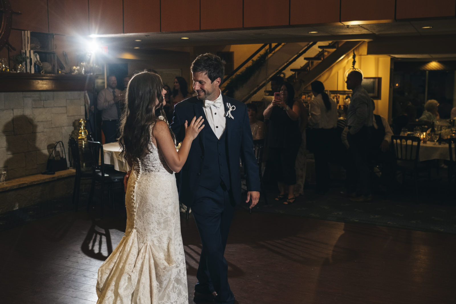 Bride and groom make their way to the dance floor for their first dance in Michigan.