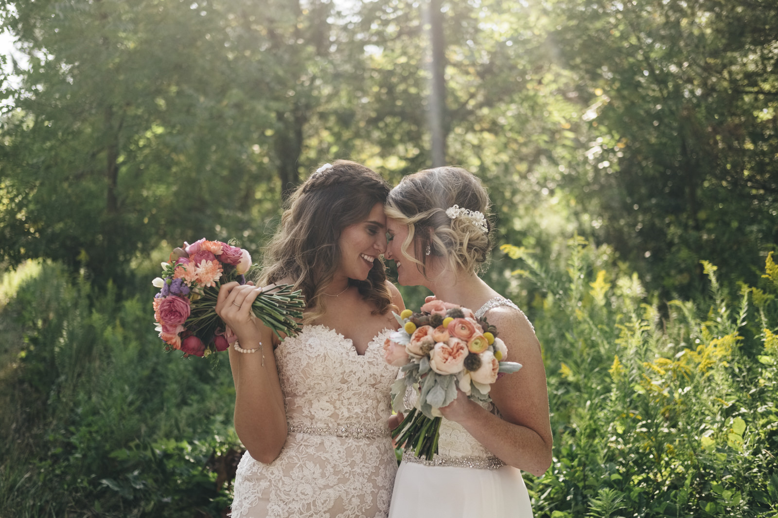 Chris and LeeAnn, two brides, go in for a kiss during their creative session in Toledo, Ohio.