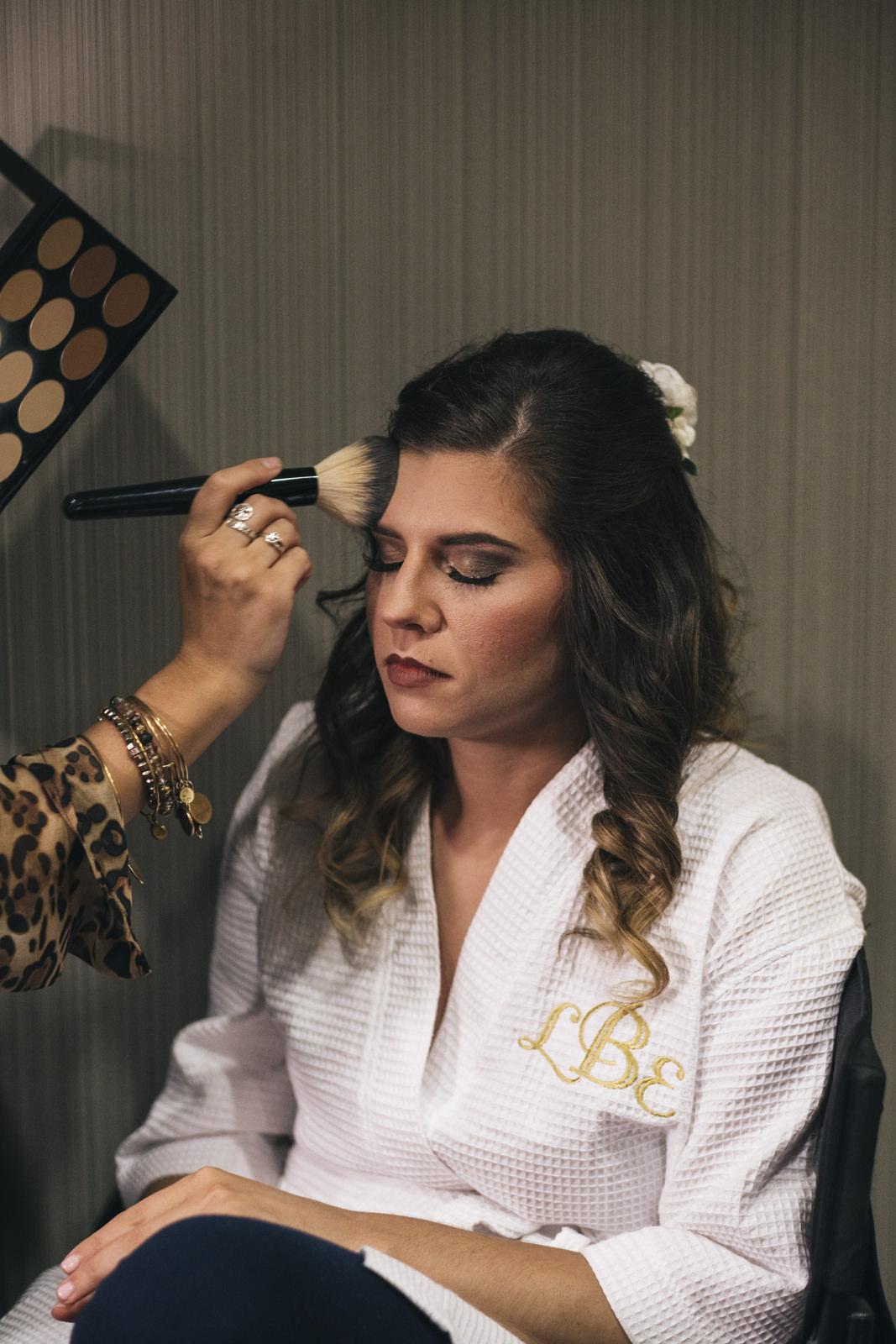 LeeAnn gets her makeup done before her wedding ceremony in Toledo, Ohio.