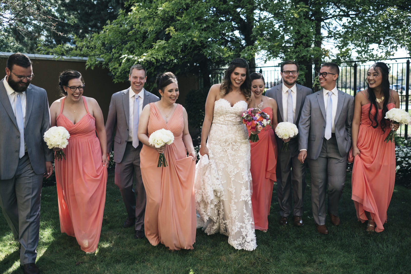 The bride walks with her bridal party through the garden at Maumee Marriott hotel in Ohio.