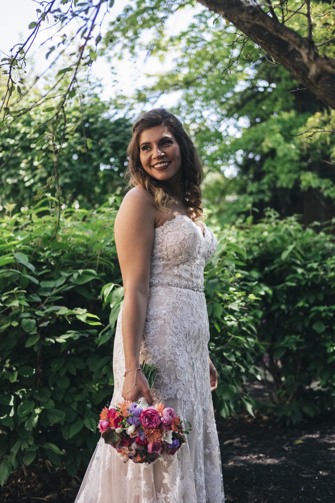 Bride stands in the garden before her wedding in Toledo, Ohio.