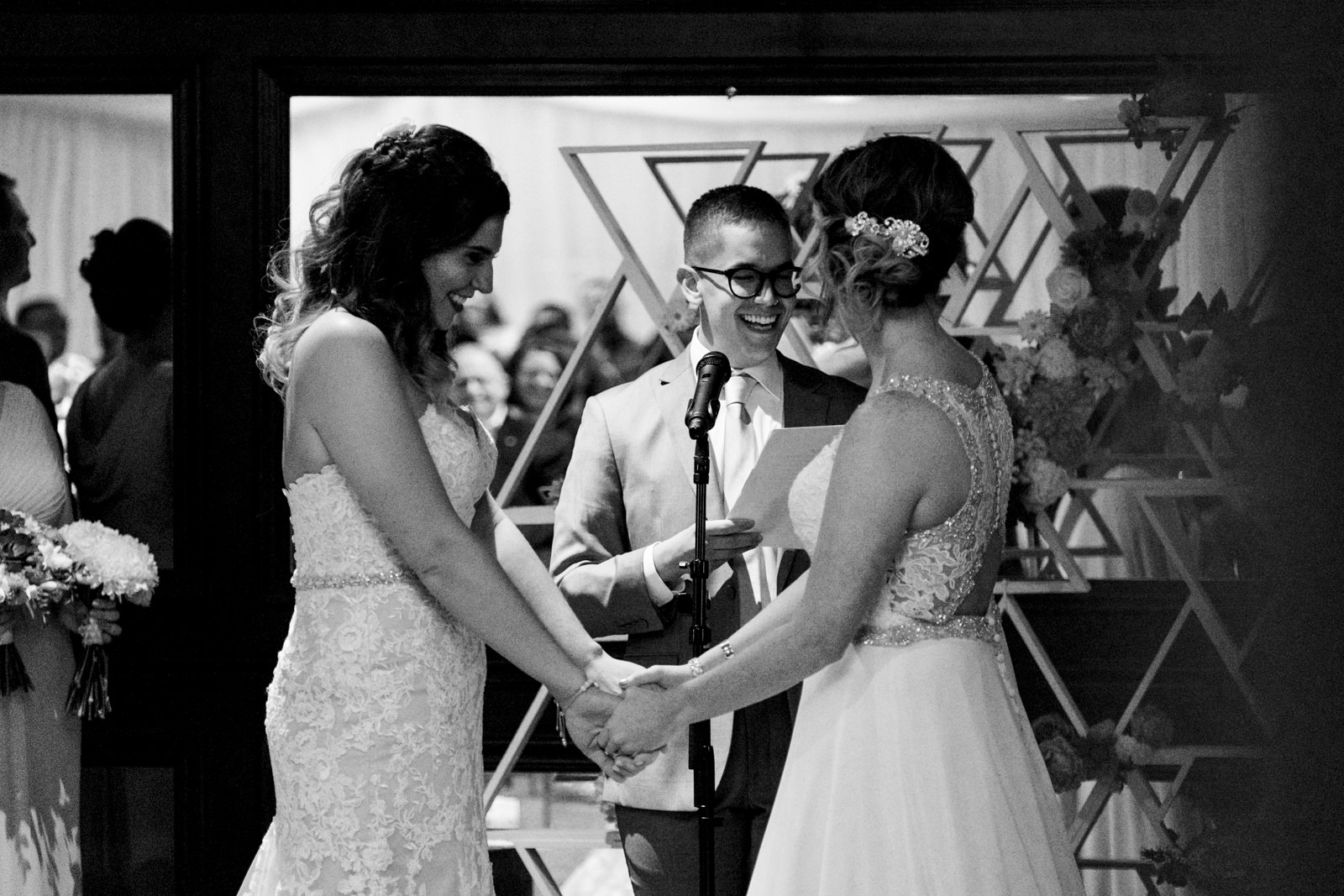 Lesbian couple, Chris and LeeAnn stand at the alter for their wedding ceremony at The Premier