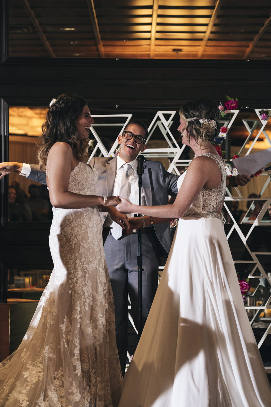 Same-sex brides laugh during their wedding ceremony as they are married in Toledo, Ohio.
