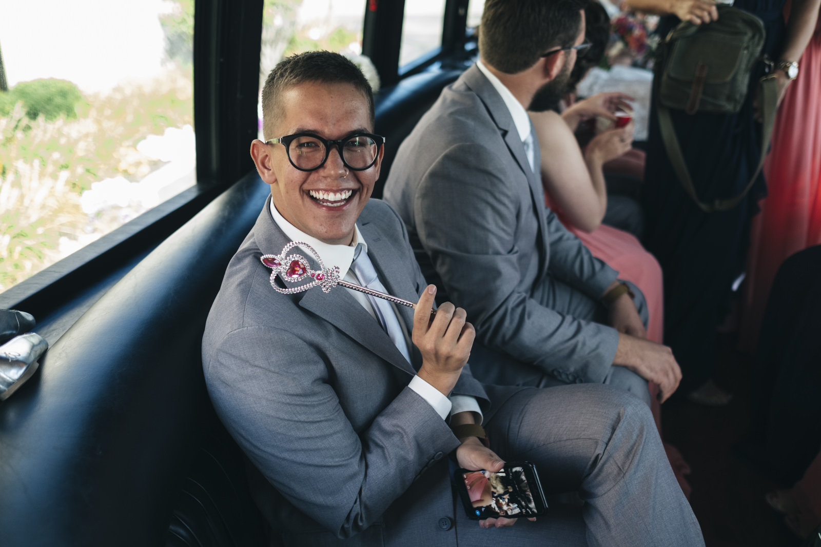 Officiant sits in a Childers party bus on the way to Swan Creek Park in Toledo, Ohio.