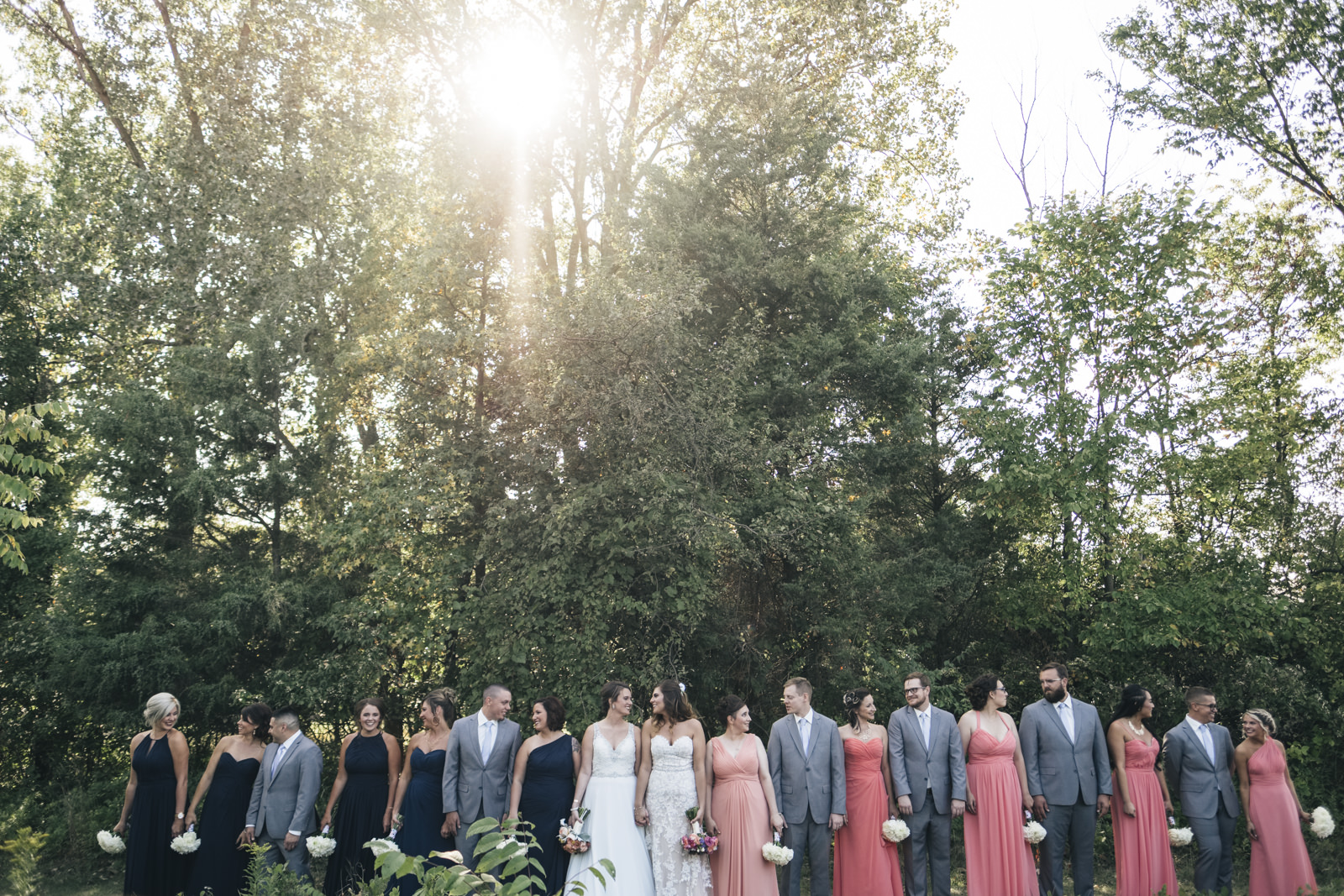 Brides and bridal party head to Swan Creek Metropark in Toledo, Ohio after wedding ceremony at The Premier.