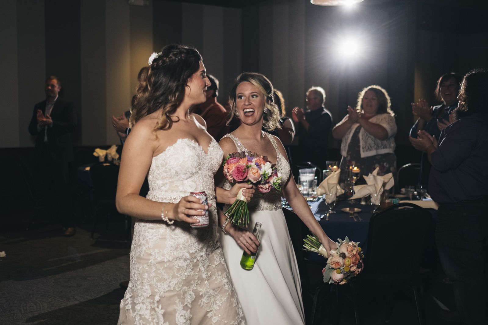 Brides enter their reception at The Premier in Toledo, Ohio.