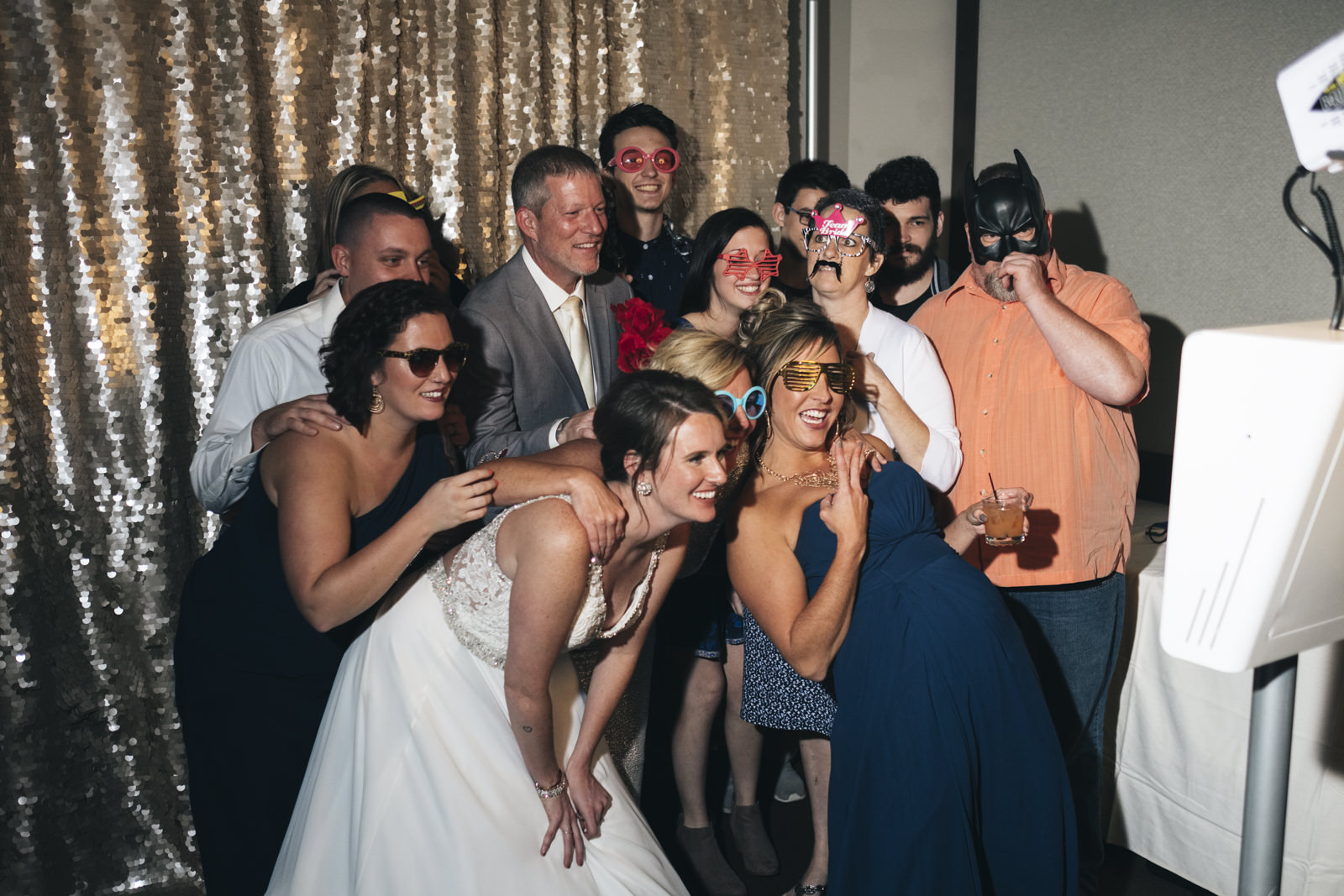 Bridal Party takes a picture in Swatch Photobooth.
