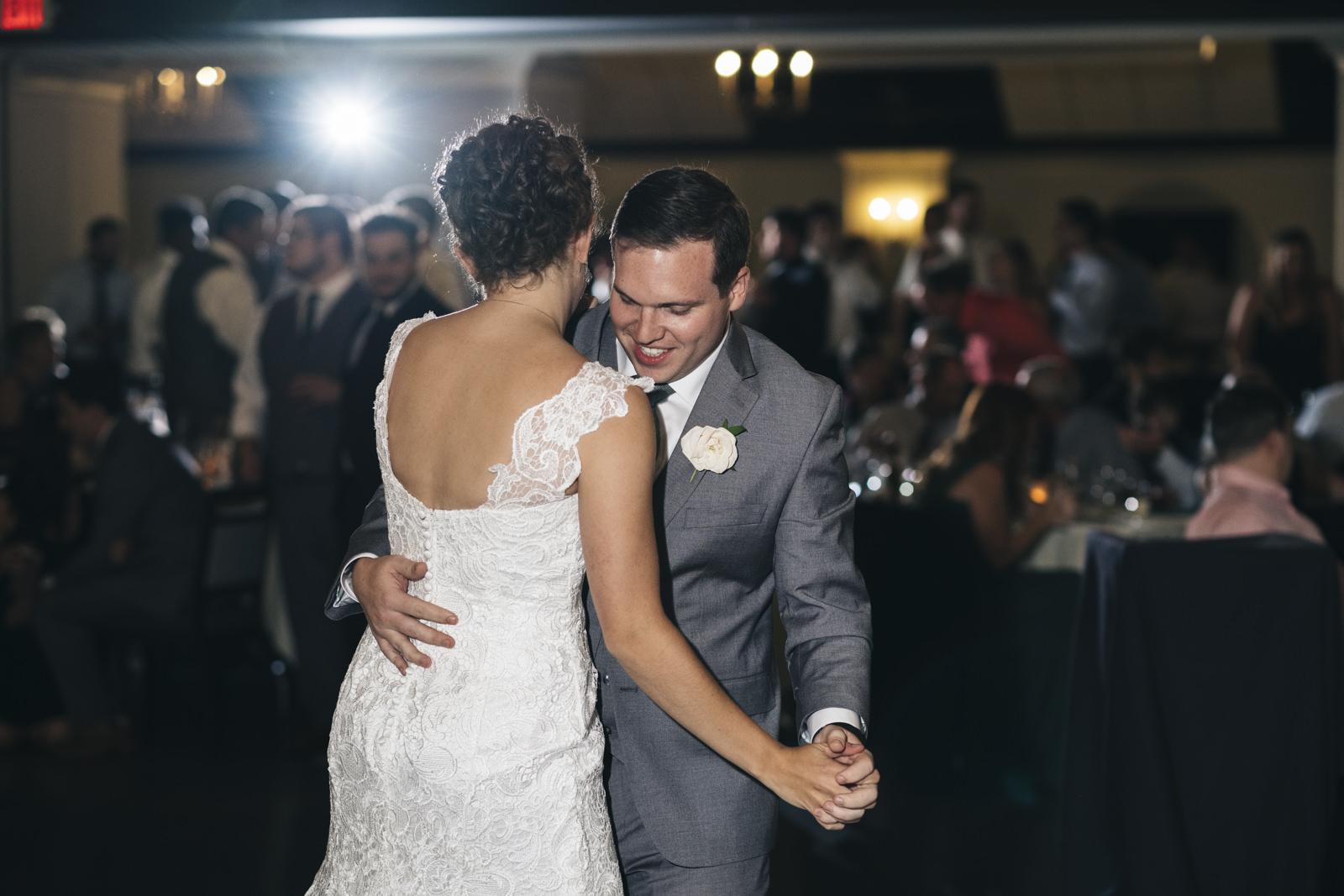 Bride and groom share their first dance in front of their closest family and friends at the Toledo Zoo.