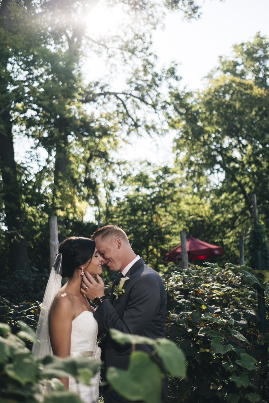 Bride and groom lean in for a kiss during their creative session with Swatch Studios in Marblehead, Ohio