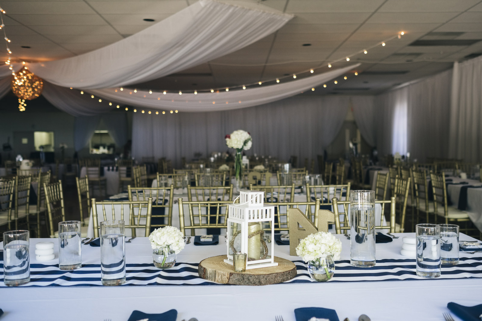 The tables are all set up for a nautical themed wedding near Lake Erie in Ohio