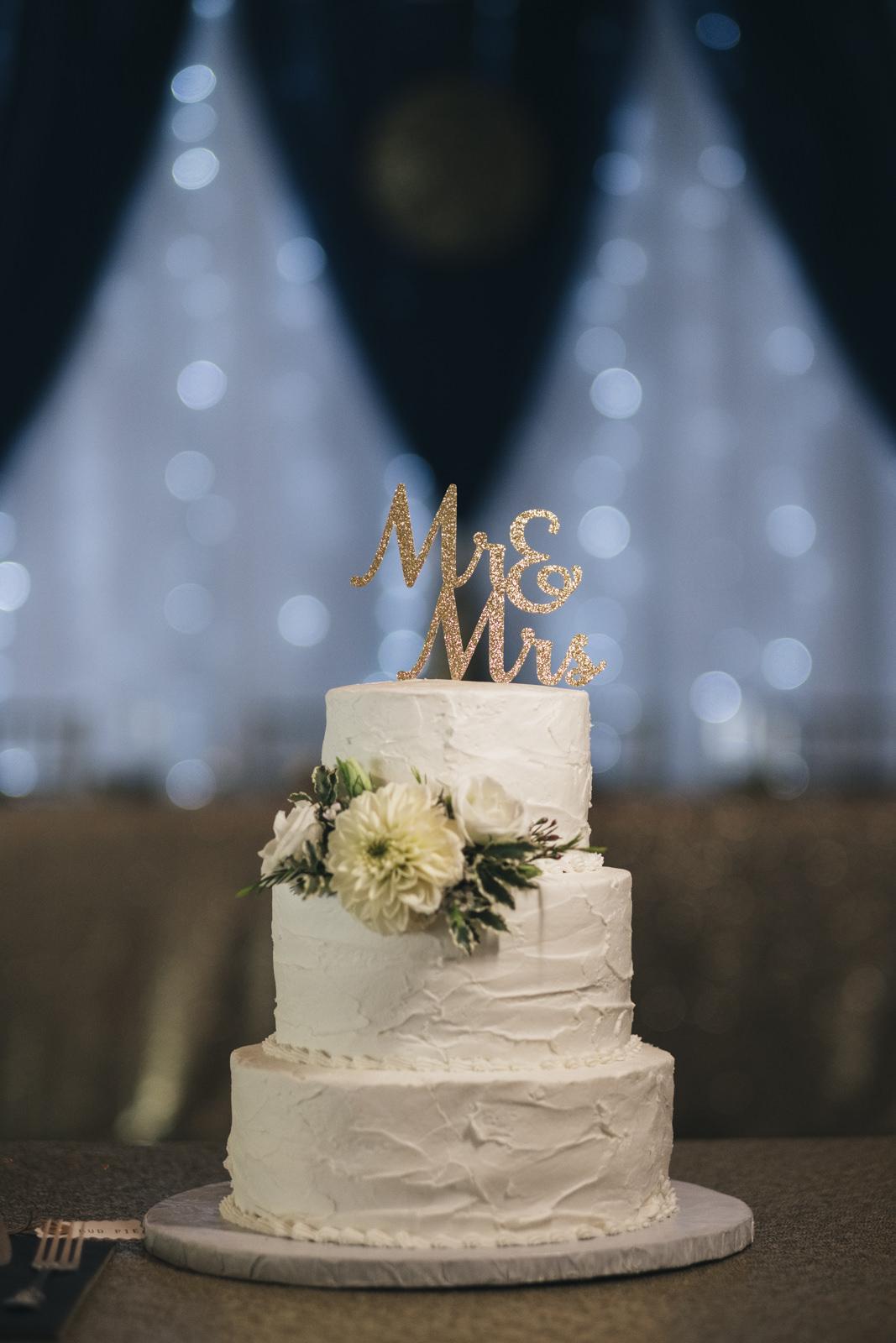 The bride and groom's wedding cake is from Cigi Cakes custom design in Marblehead Ohio