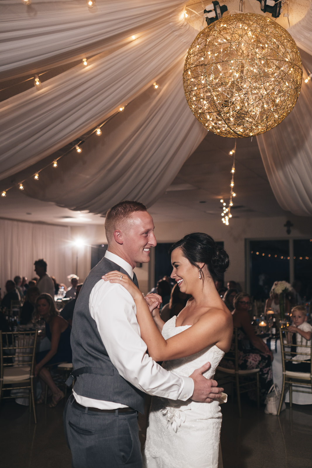 Bride and groom dance their first dance as husband and wife in marblehead, Ohio wedding reception