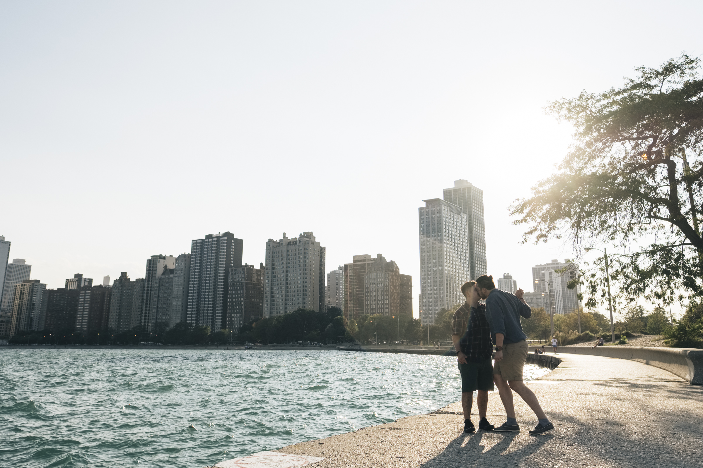 Gay couple dances on the edge of the water near Lake Michigan