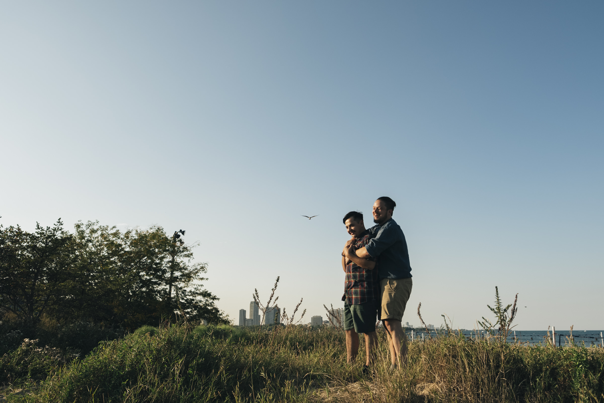 Cute couple laughs on the beaches of Lake Michigan in Illinois