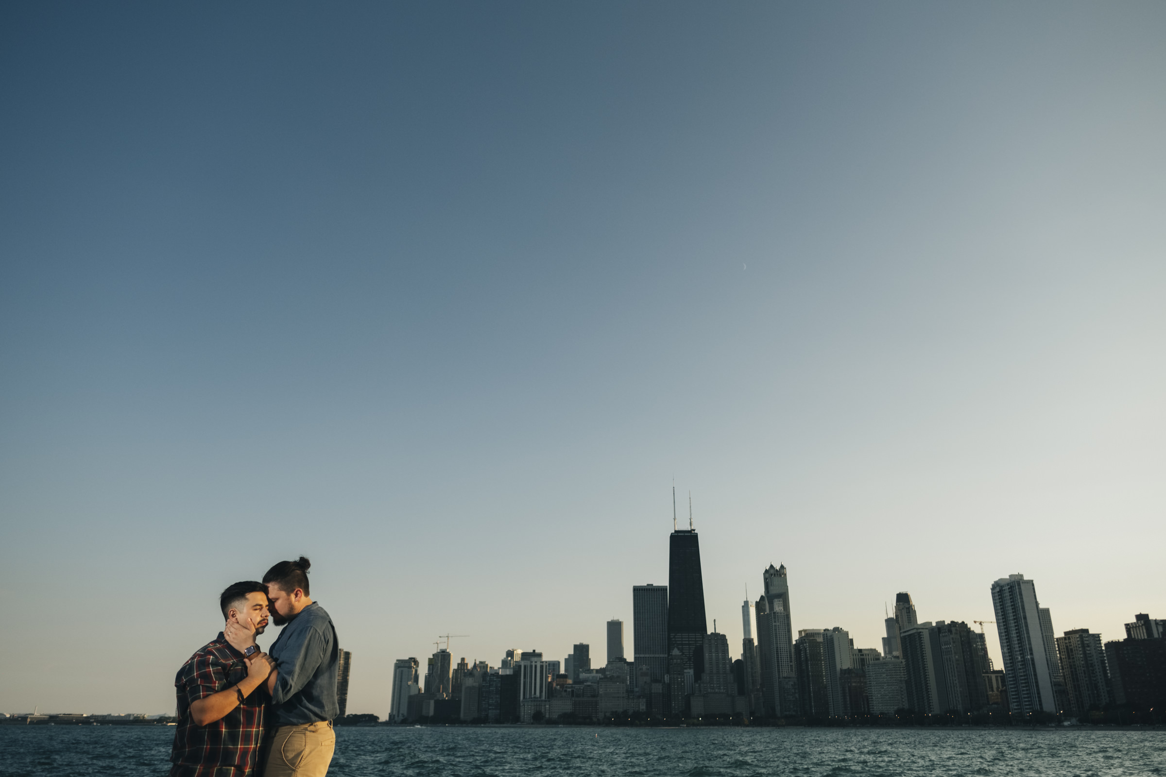 Gay couple stands for picture during their engagement session in Chicago