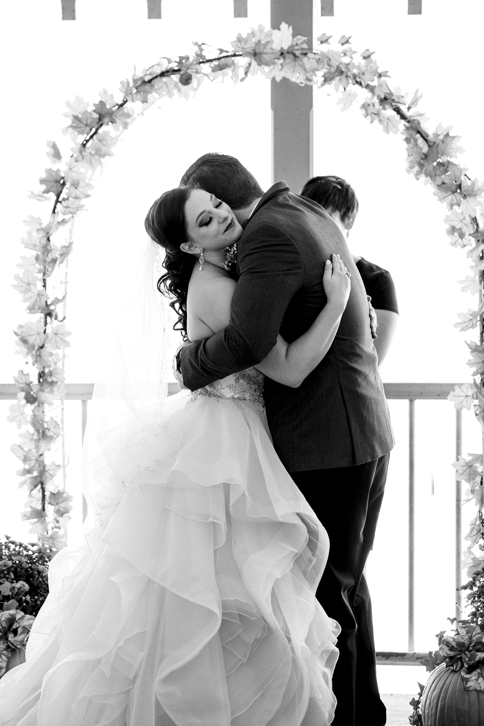 Couple hugs after they kiss for their wedding ceremony near Port Clinton, Ohio