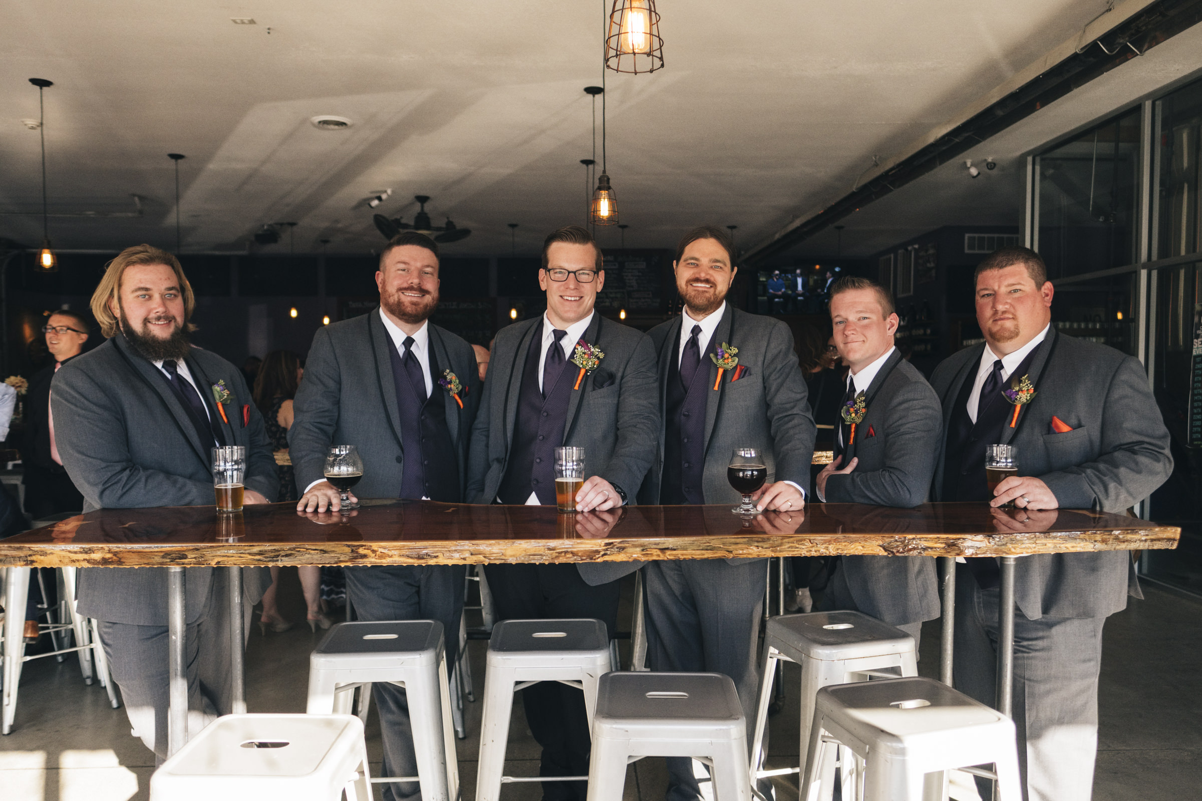 Groomsmen stand for a picture at a brewery in Port Clinton Ohio