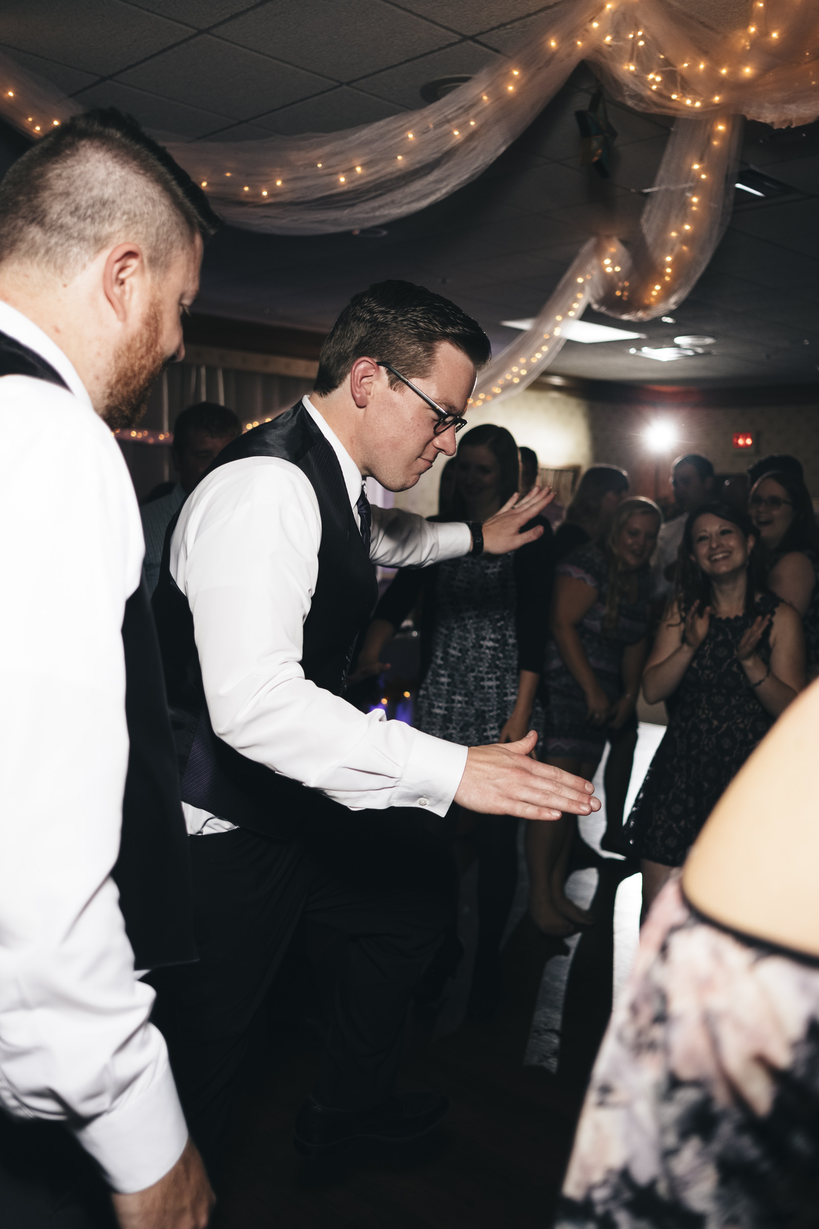 Groom dances during the wedding reception at Elks Lodge Ohio