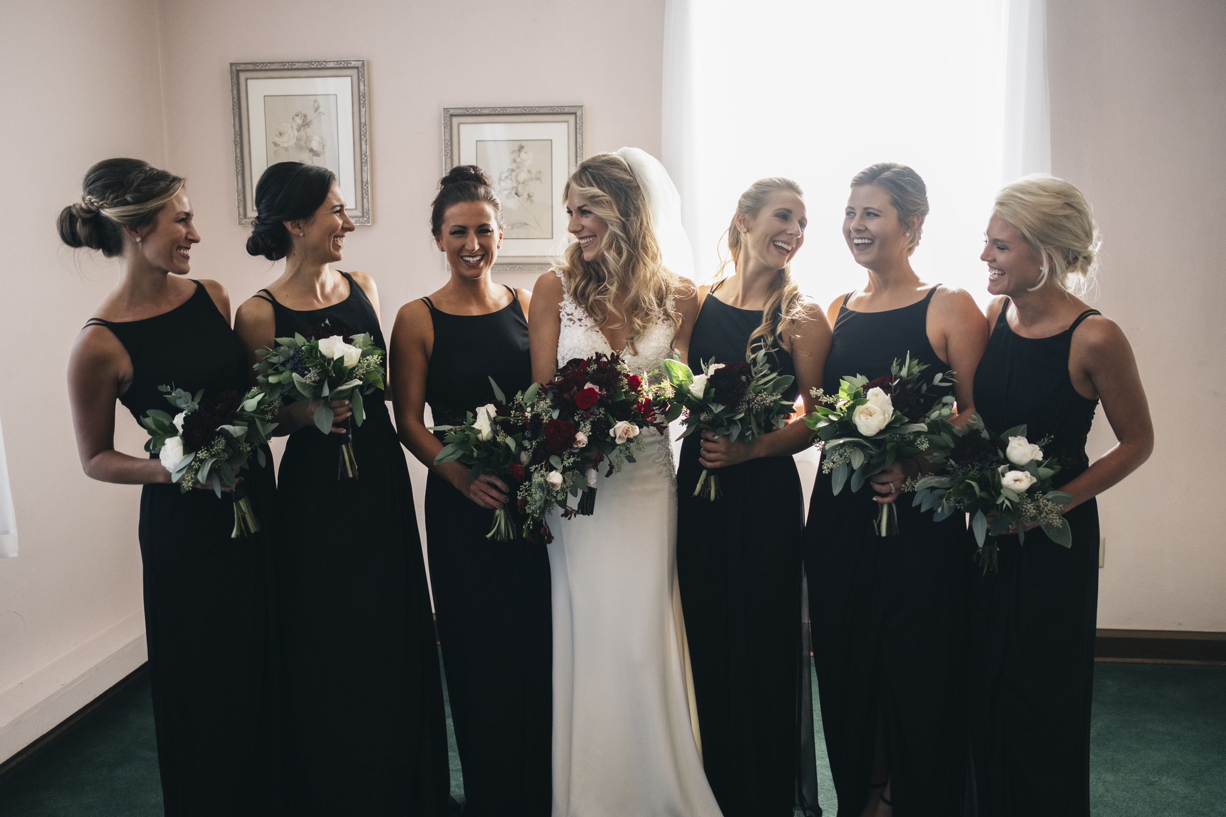 The bridesmaids stand around the bride before Grand Rapids Ohio wedding ceremony