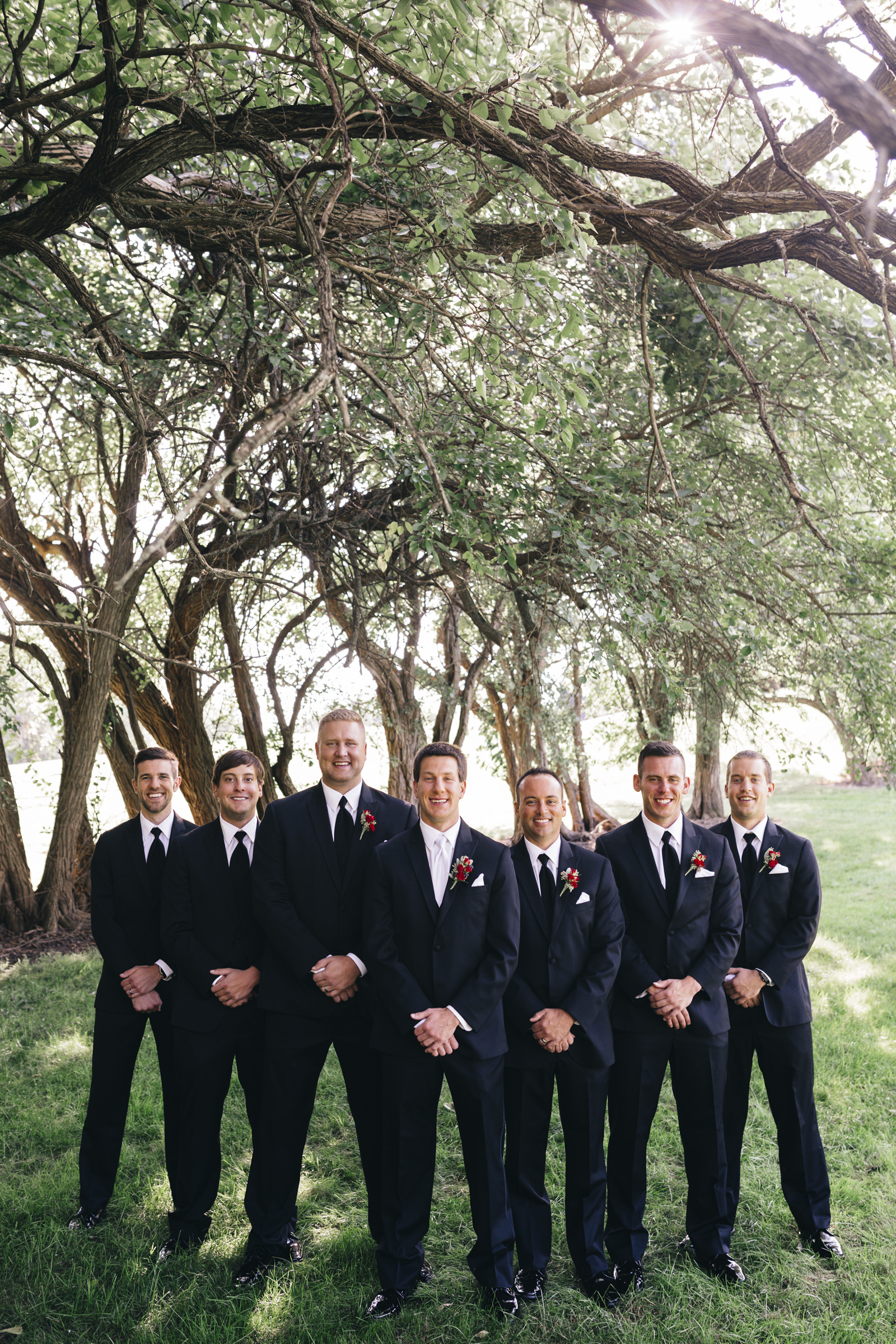 Groomsmen smile for a picture before wedding ceremony in Toledo, Ohio