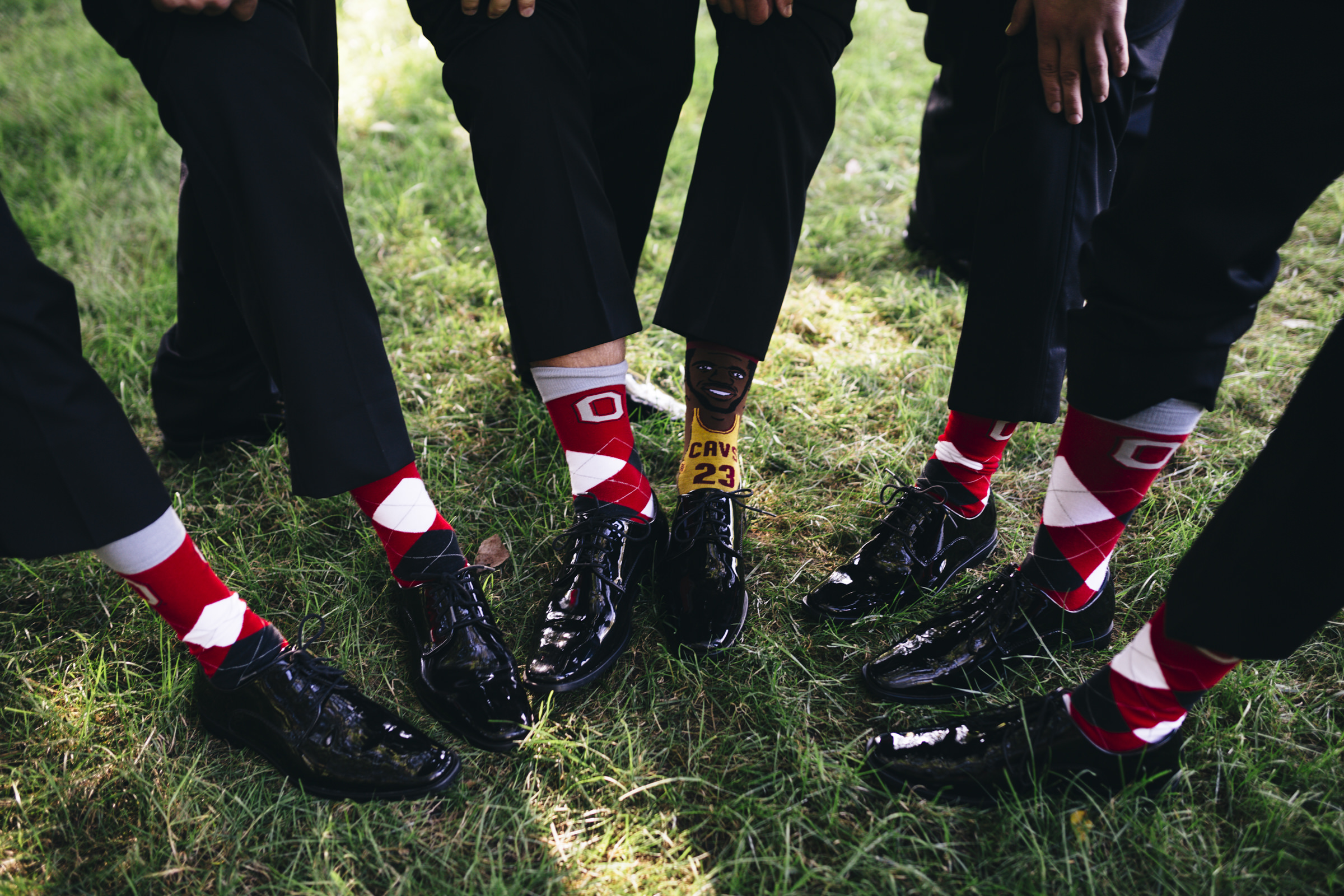 The groomsmen show off their unique socks featuring Ohio State and The Cavs