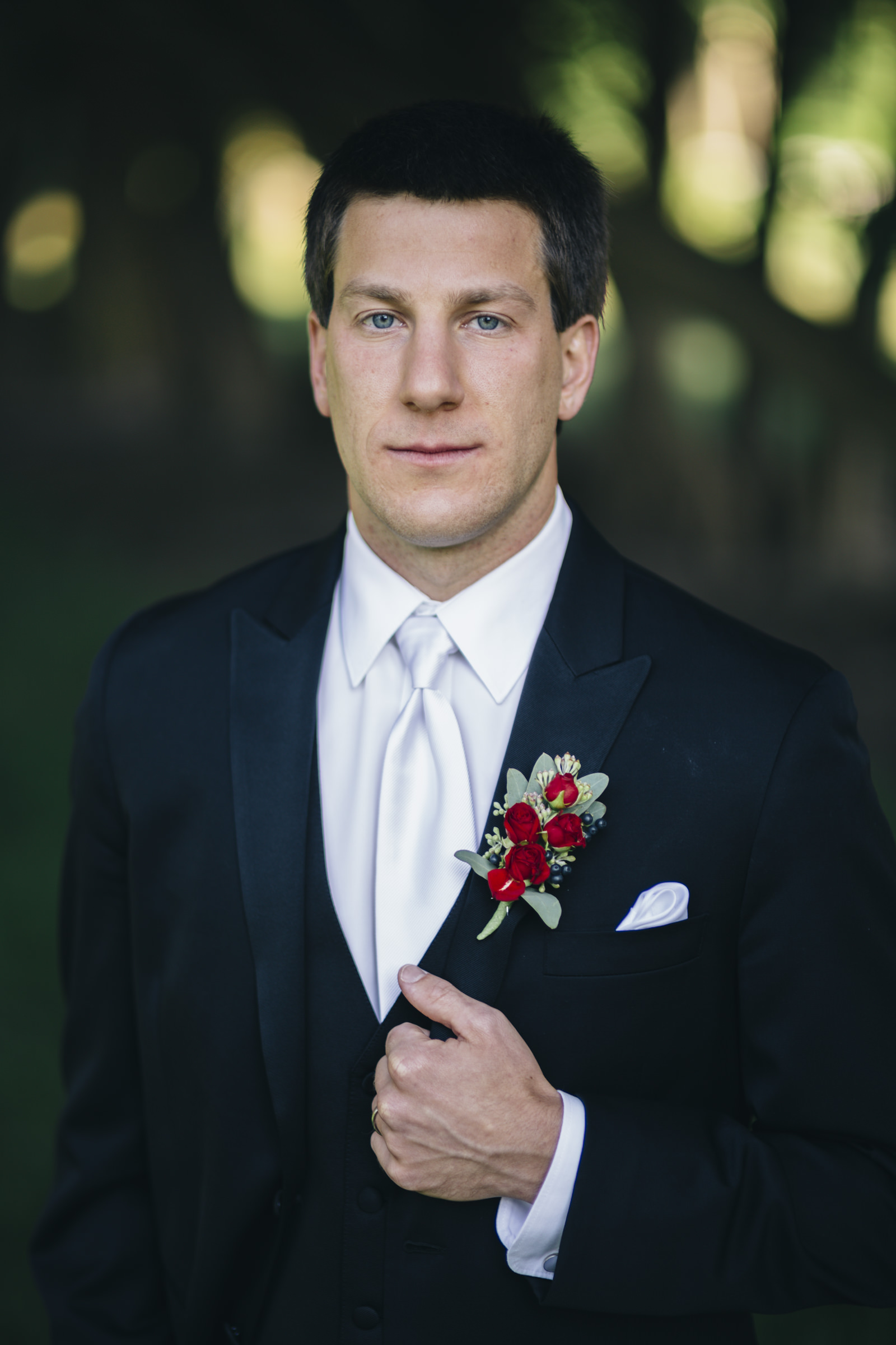 Portrait of the groom before wedding reception at Nazareth Hall