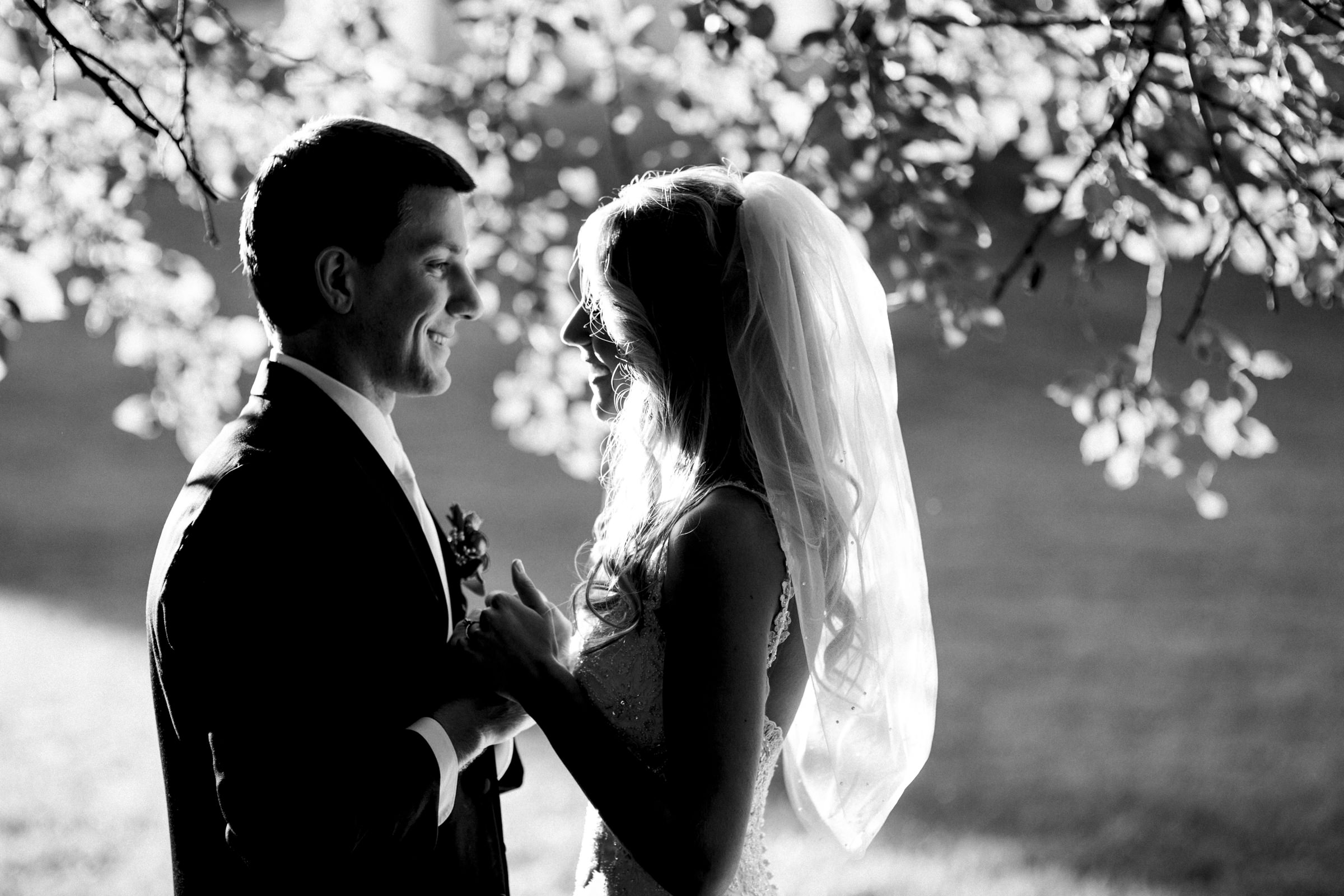 Bride and groom share an intimate moment after their wedding ceremony in Grand Rapids Ohio