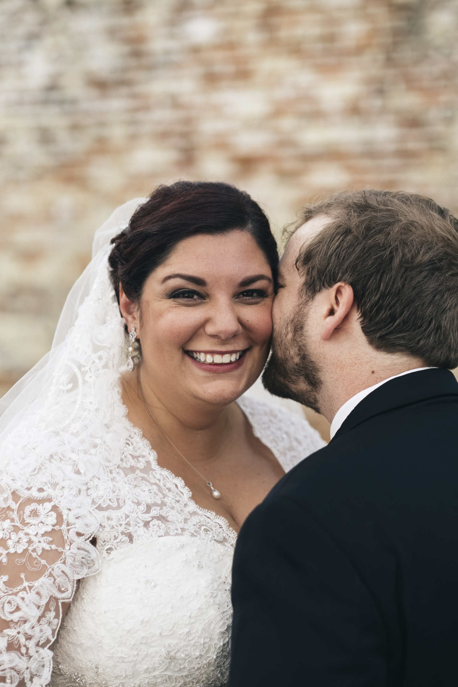 Bride and groom smile during their wedding photos
