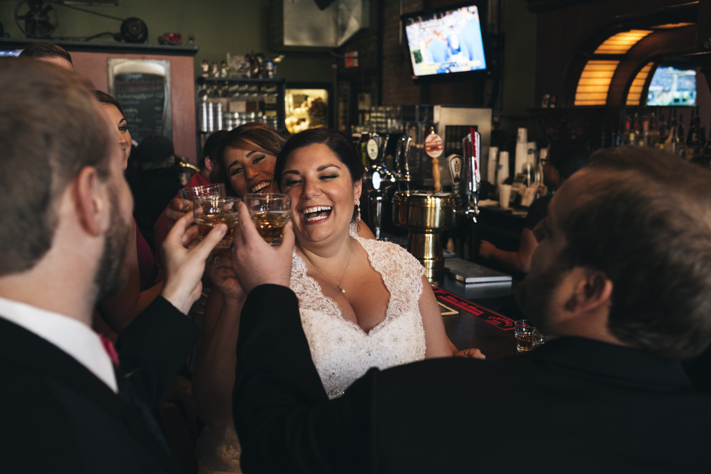 The bride and groom visit The Blarney in downtown Toledo for a drink before their wedding reception