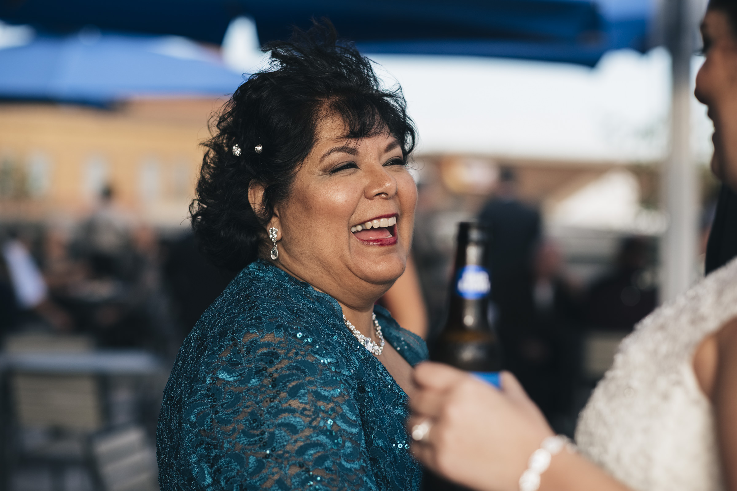 Mother of the bride wears turquoise at her daughter's wedding