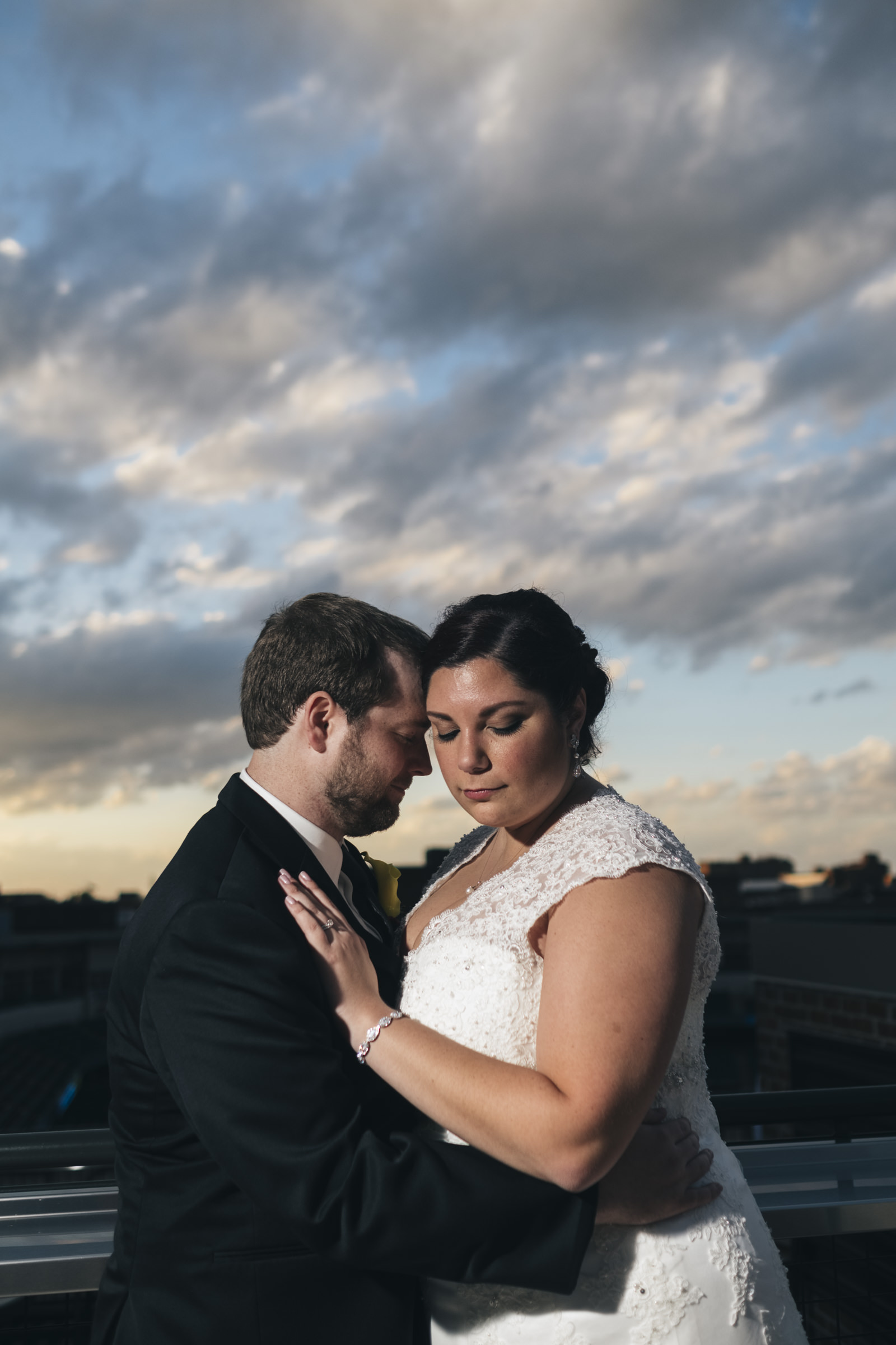 Couple stands on the rooftop of Top of Nine in downtown Toledo