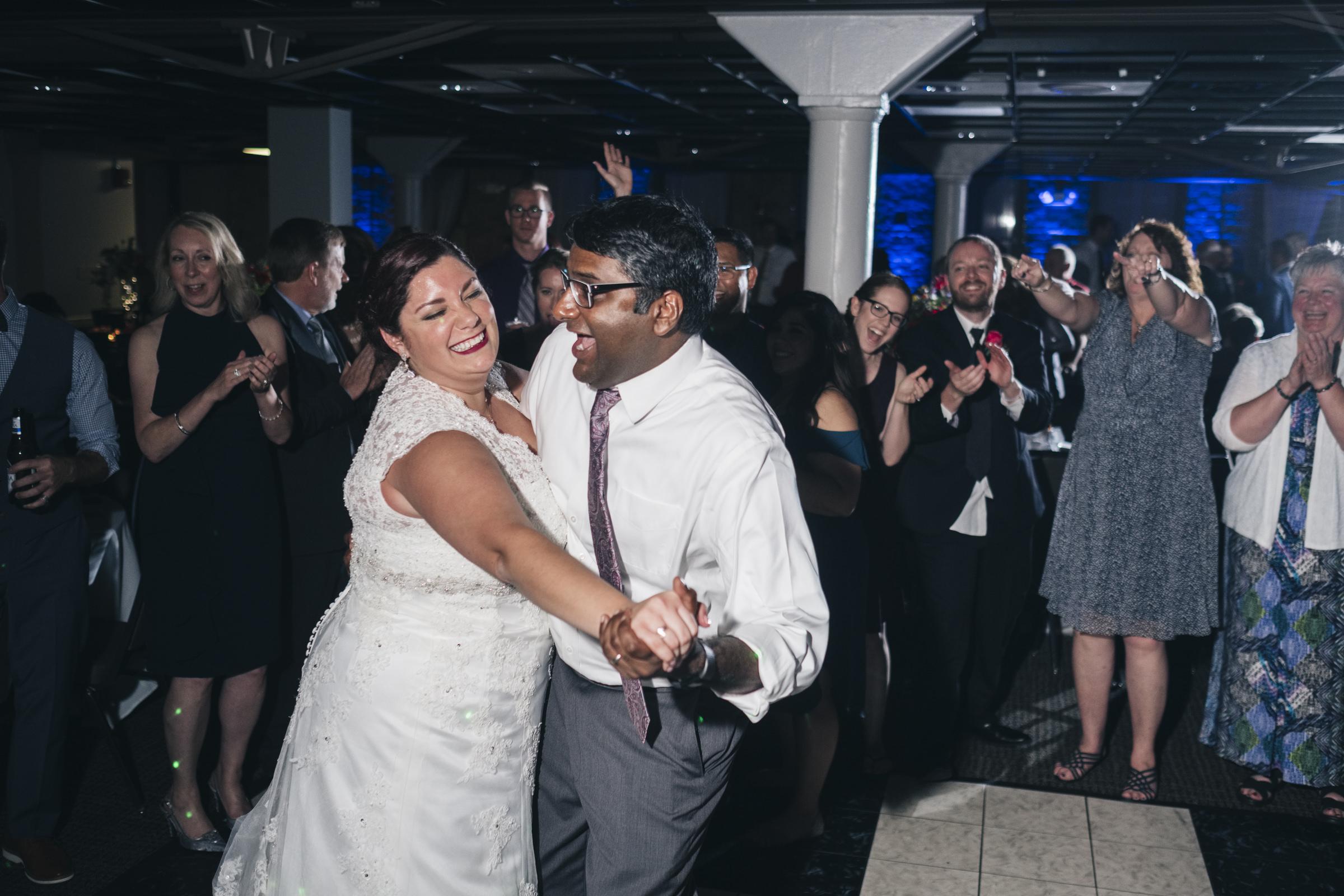 Bride dances with her friend at Hensville Stadium wedding