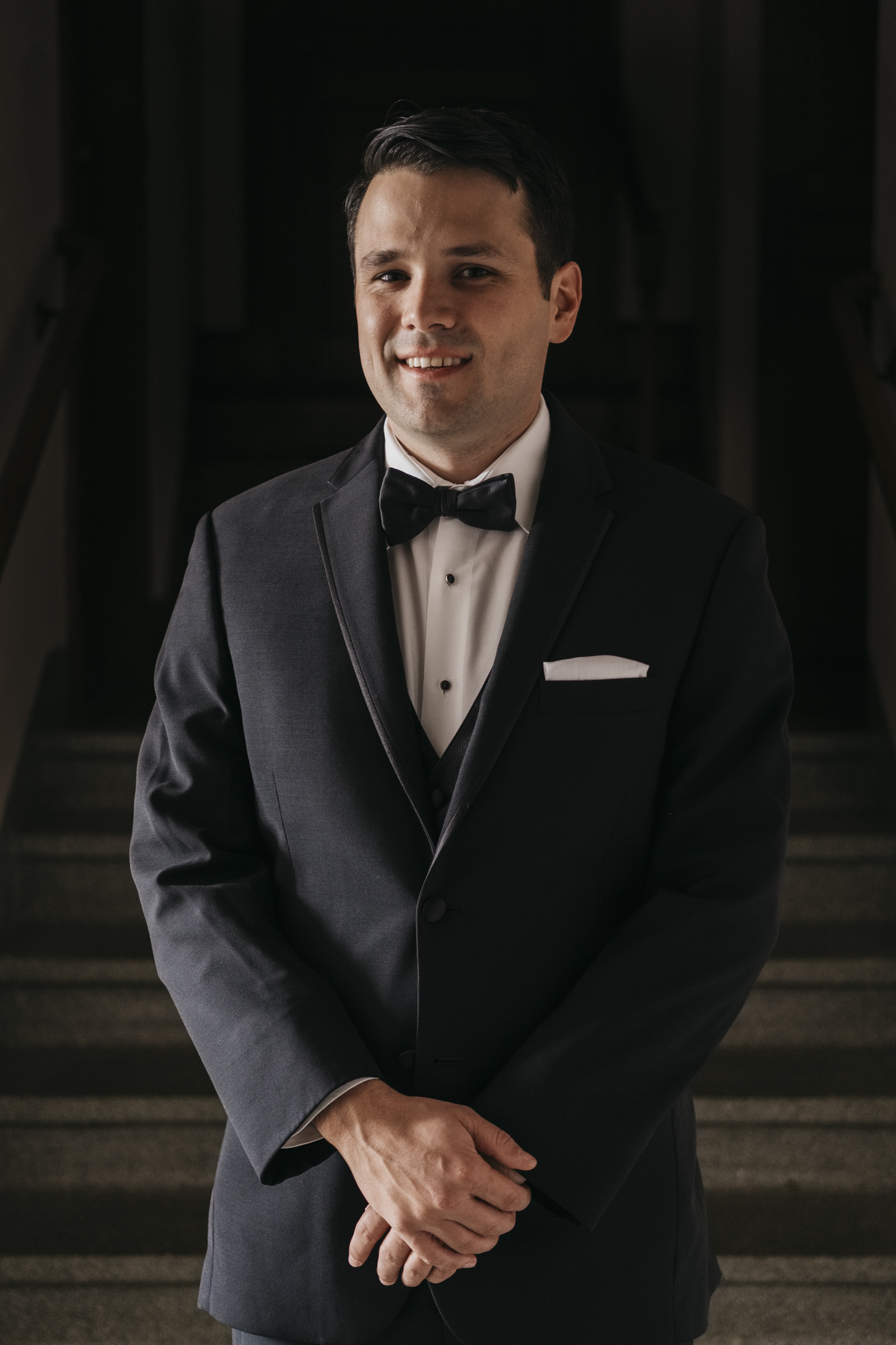 Groom smiles for a portrait before his wedding ceremony taken by the best Ohio wedding photographers