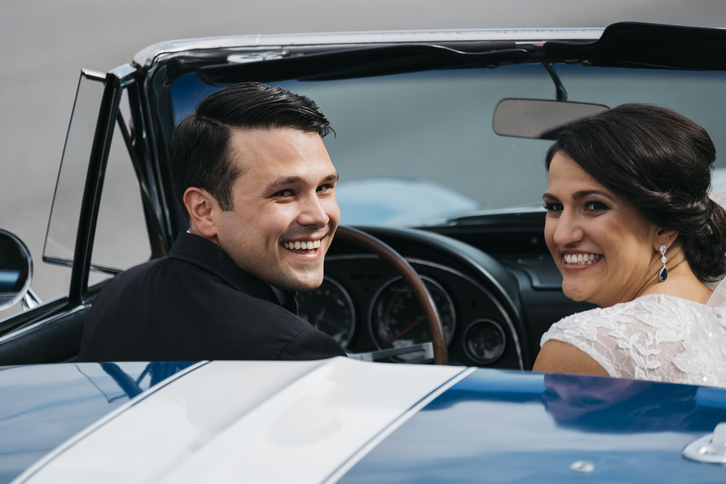 Bride and groom smile as they drive away on their wedding day in Fremont Ohio