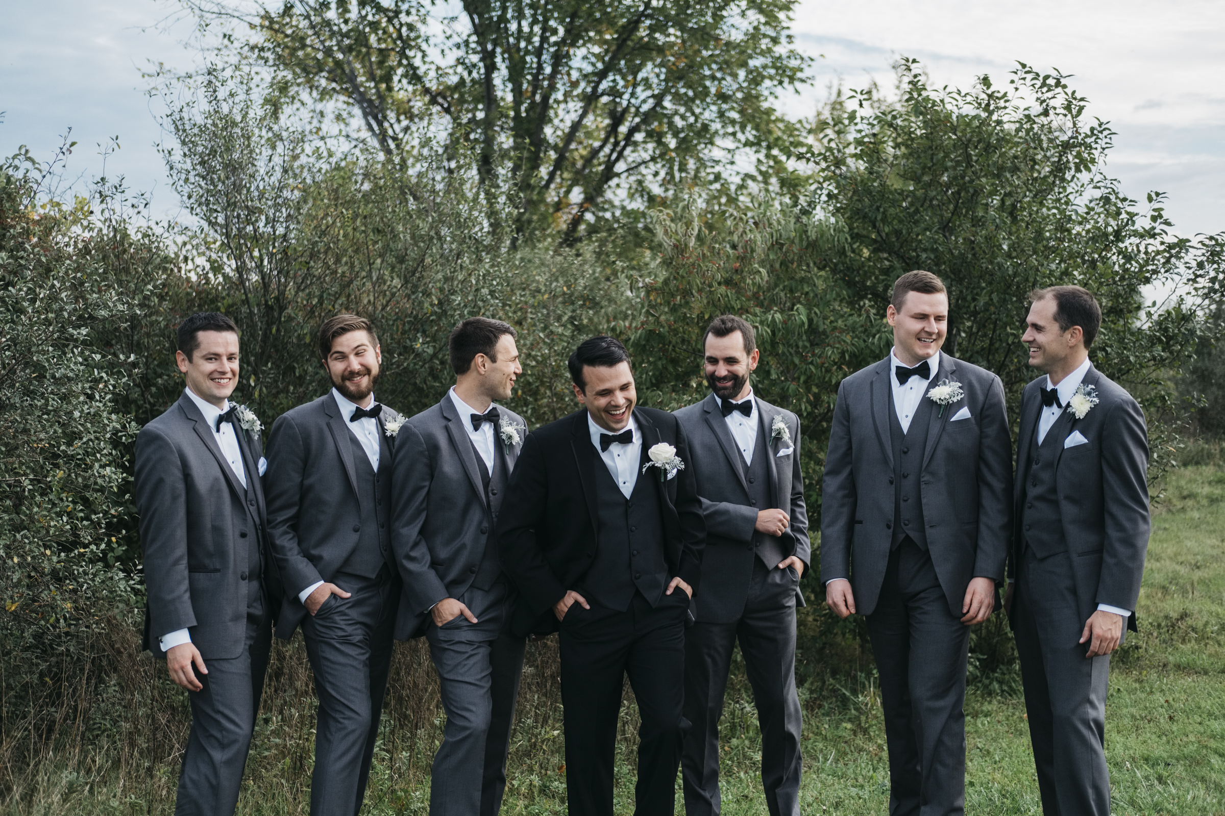 The groom stands with all his groomsmen for a picture in Maumee, Ohio