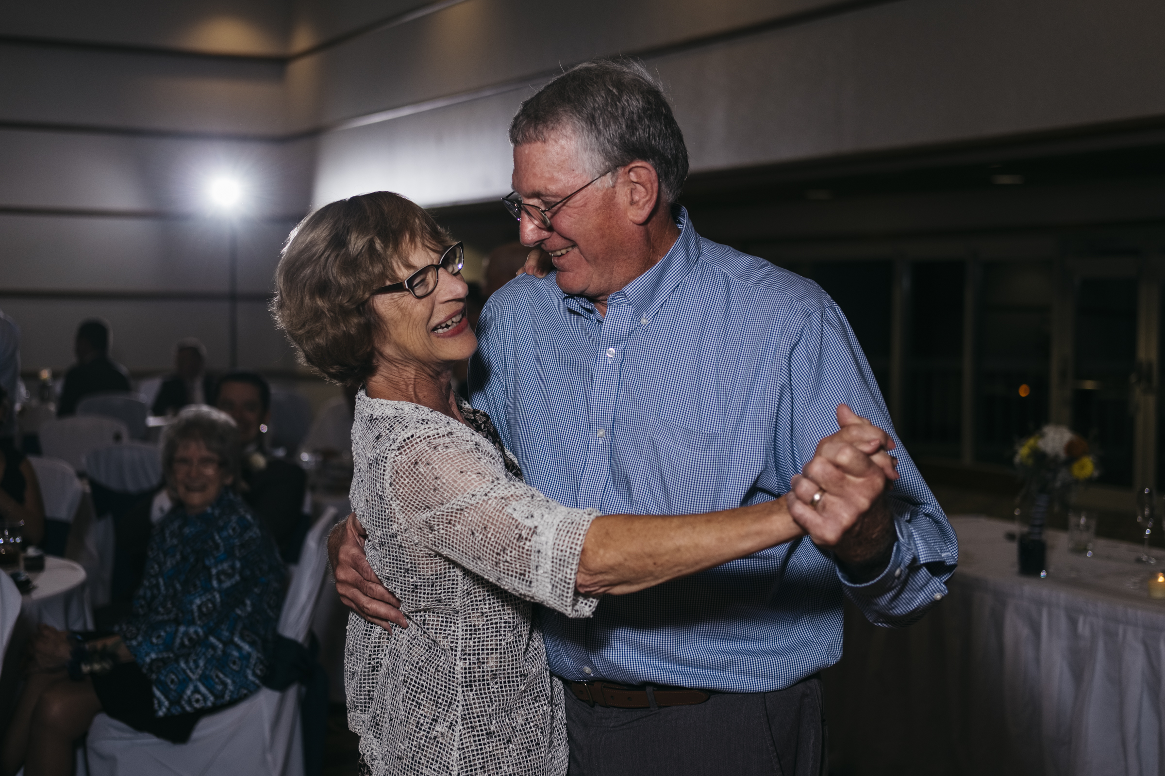 Couple dances at their friends' wedding reception in Northern Ohio to Bluewater Kings Band in toledo
