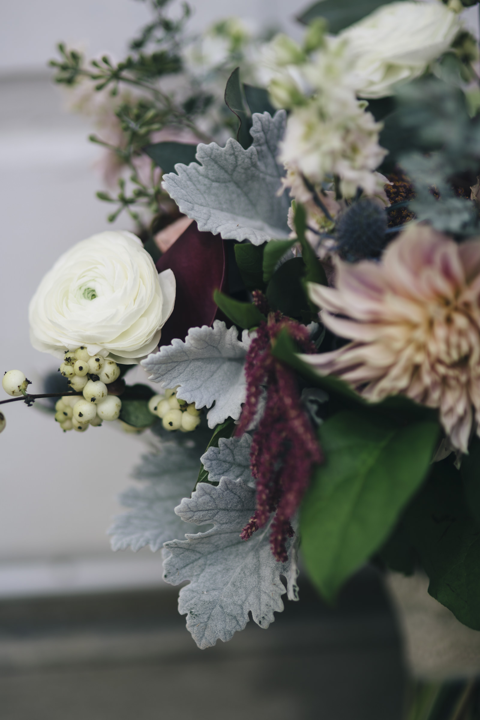 THe brides maroon and cream vintage influenced floral bouquet