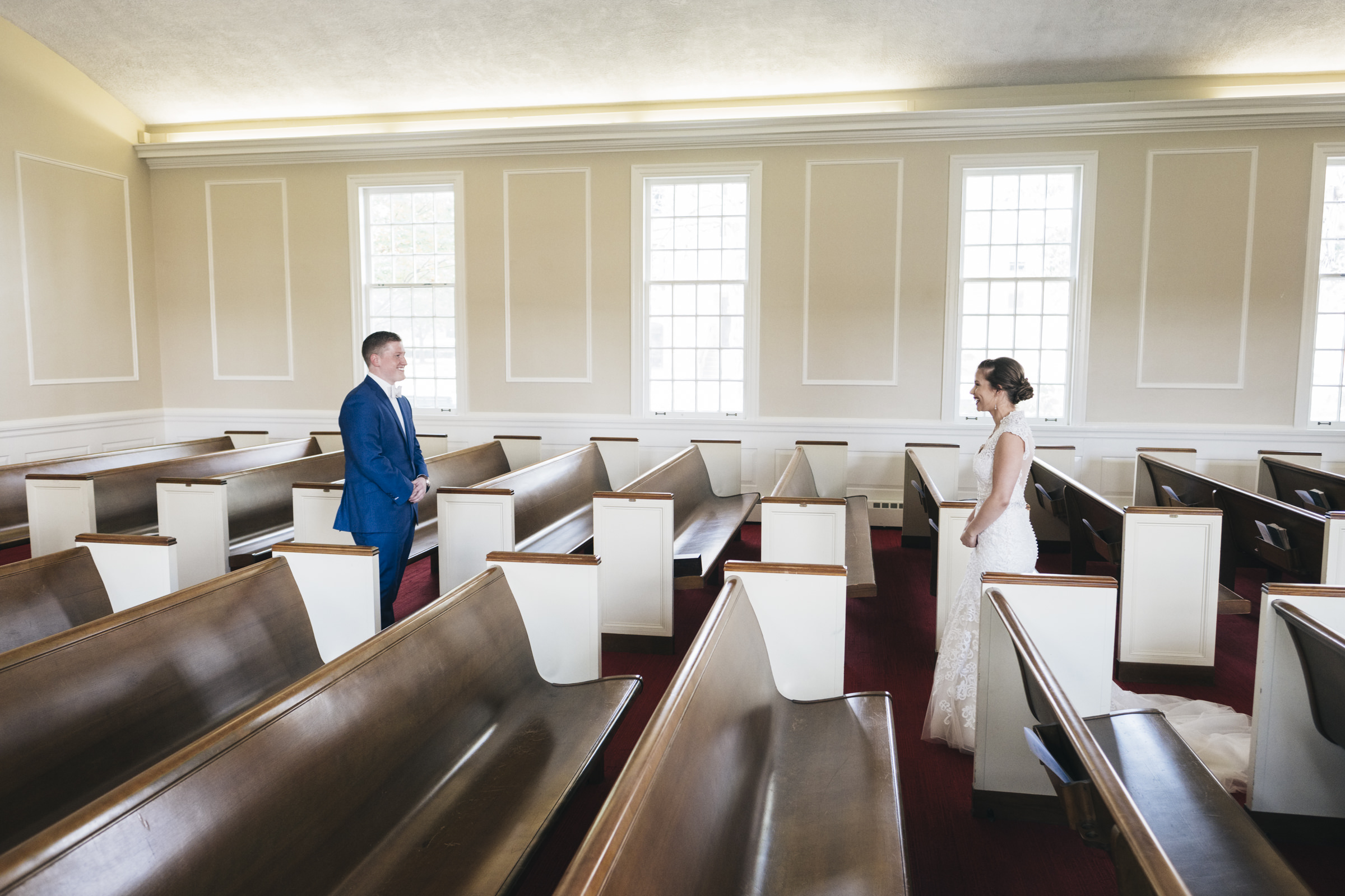 Bride and groom do a first look in BGSU's Chapel on campus