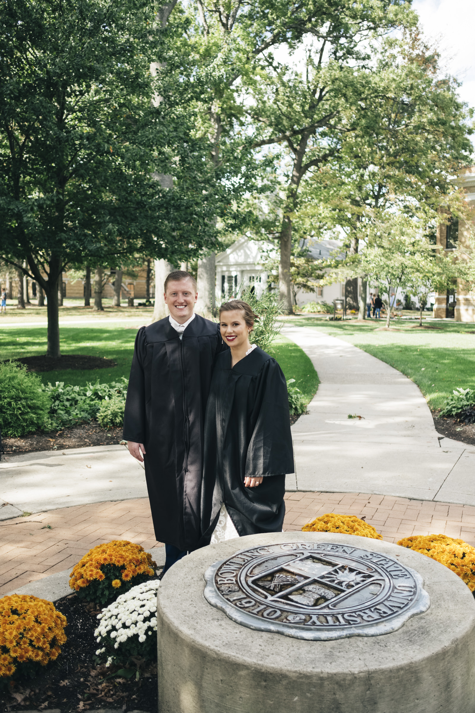 Falcon Flame couple on Bowling Green Ohio's campus before their wedding ceremony