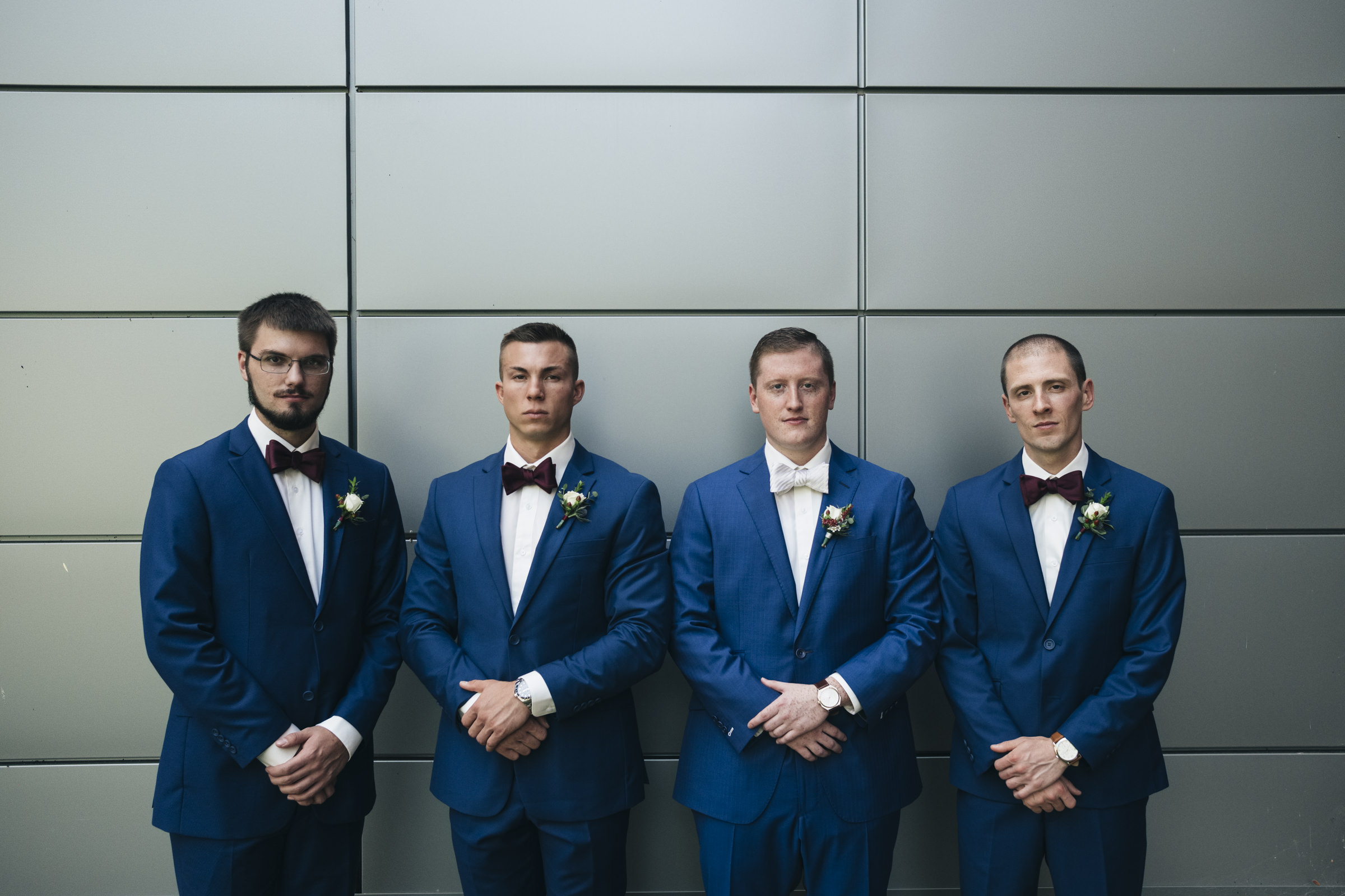The groomsmen stand with the groom on Bowling Green State University's campus before his wedding ceremony