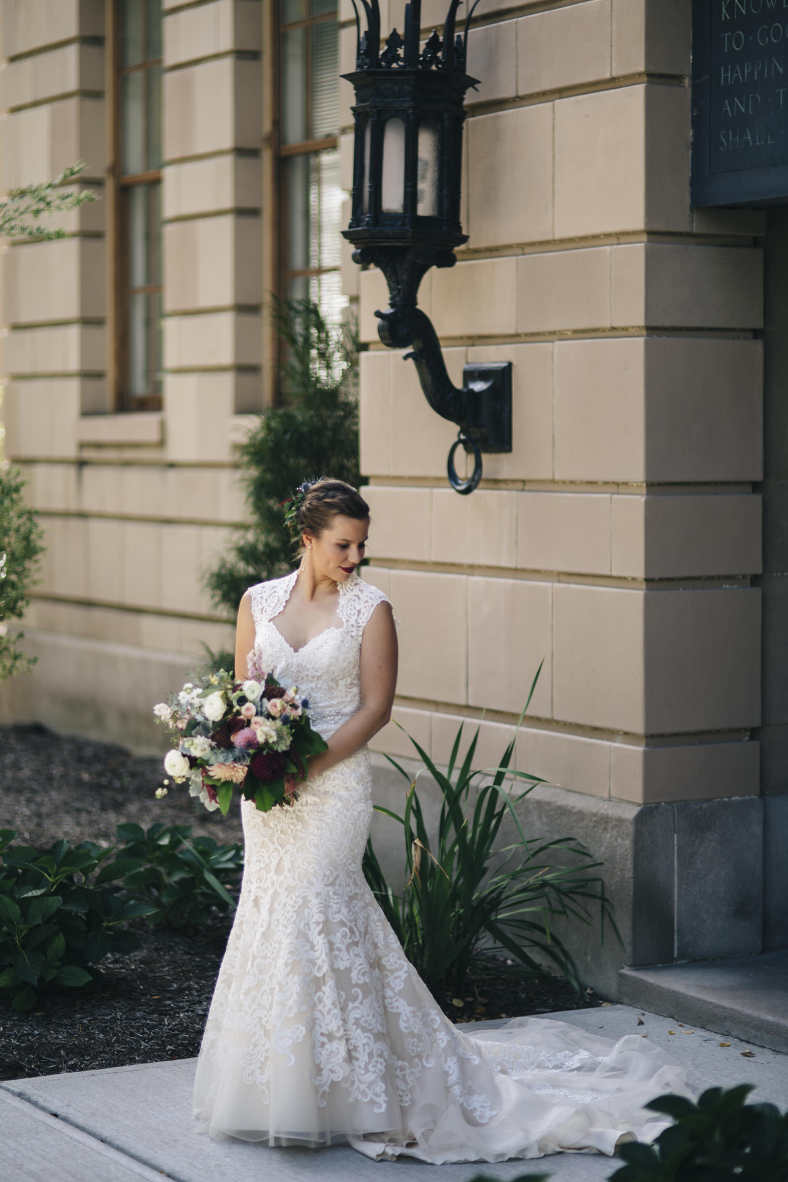 The bride stands out in front of the Admin Building on BGSU's campus