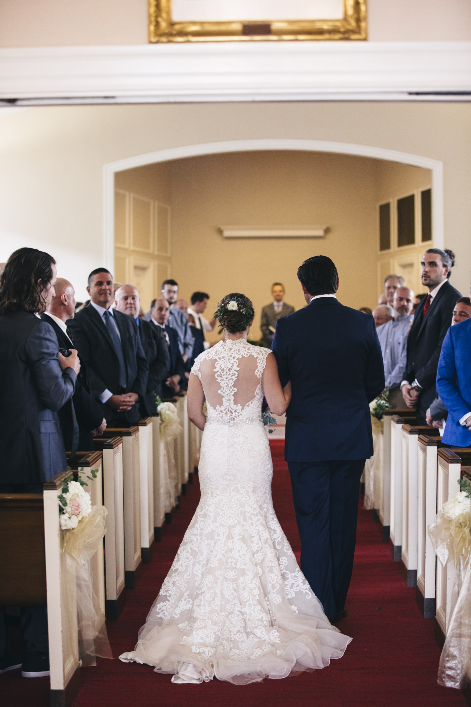 Bride is walked down the aisle for her Bowling Green Ohio wedding ceremony at BGSU