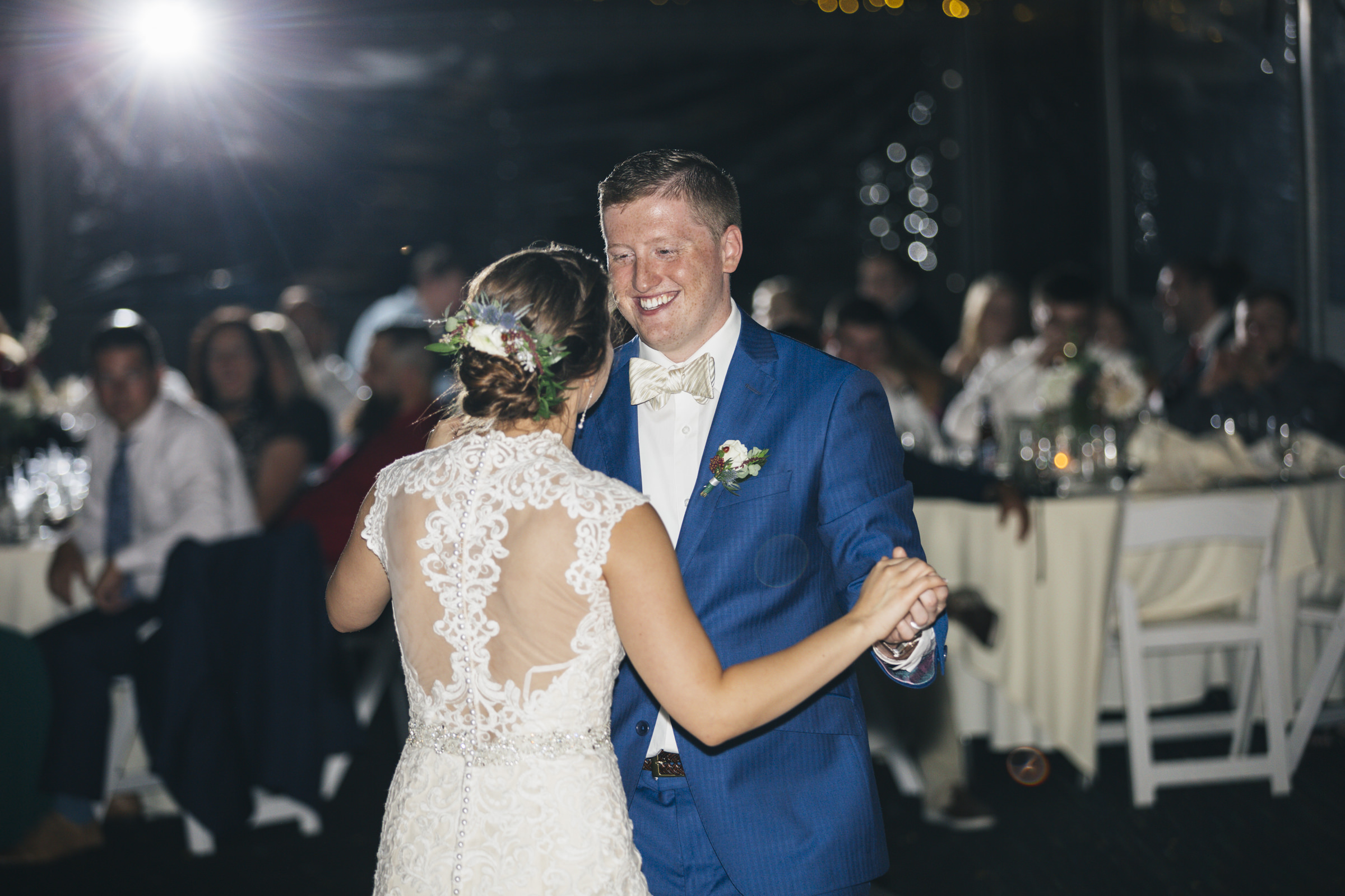 Bride and groom dance their first dance as husband and wife at Belmont Country Club near Toledo Ohio