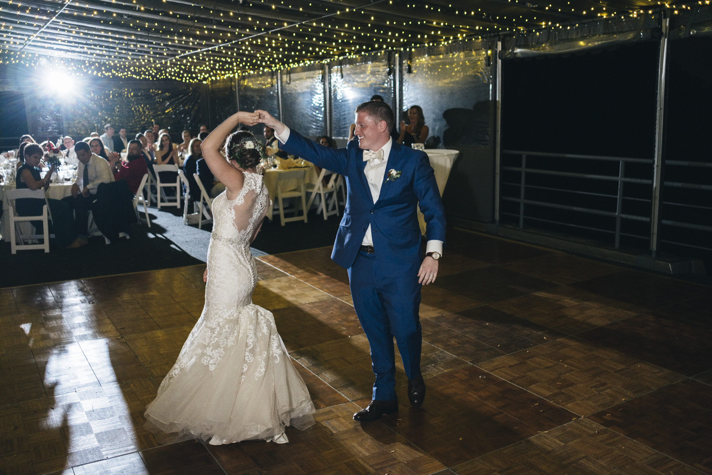 The bride spins during her first dance with her new husband at her wedding reception in Perrysburg Ohio