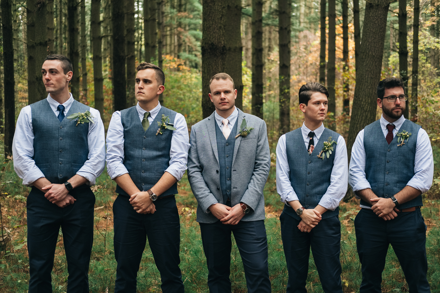 Groom stands with his groomsmen at Oak Openings park near Perrysburg Ohio
