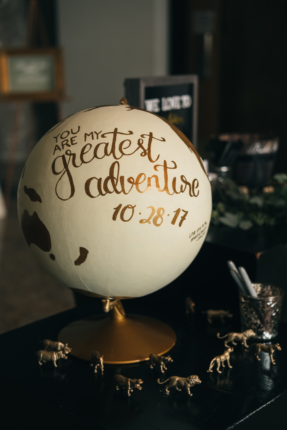 You Are My Greatest Adventure globe for guests to sign at wedding reception in Toledo, Ohio