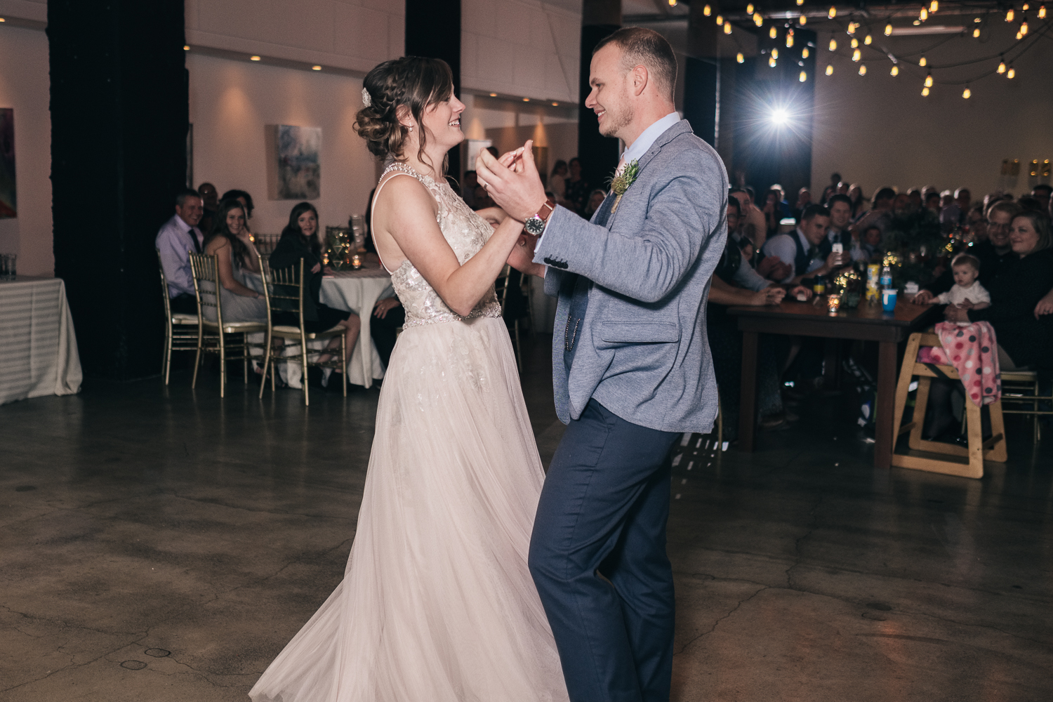 Bride and groom dance to a coreographed dance at their wedding