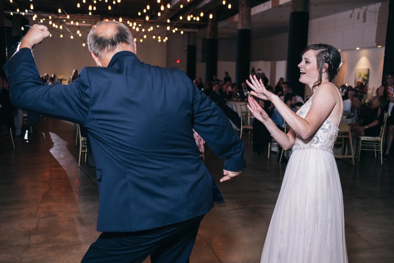 Father and daughter dance to choreographed dance at her wedding reception in Toledo