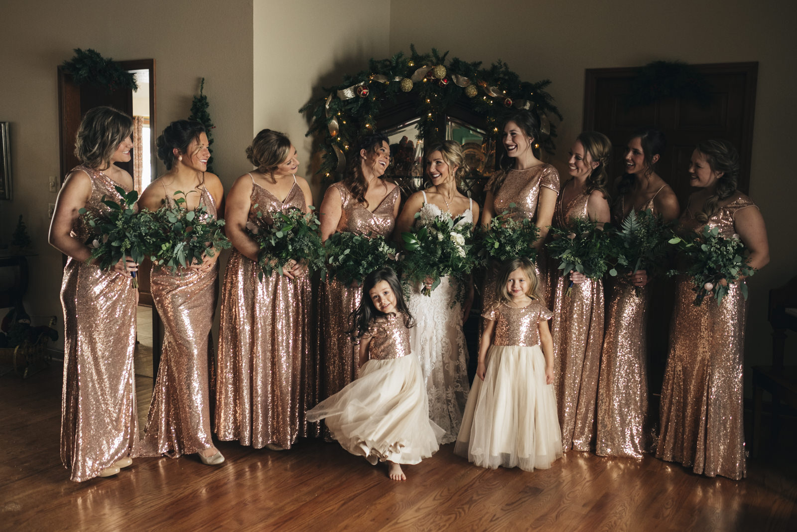 Bridesmaids in rose gold sequin dresses.